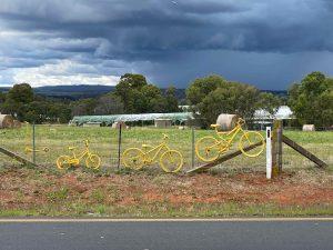 Yellow bicycle on fence